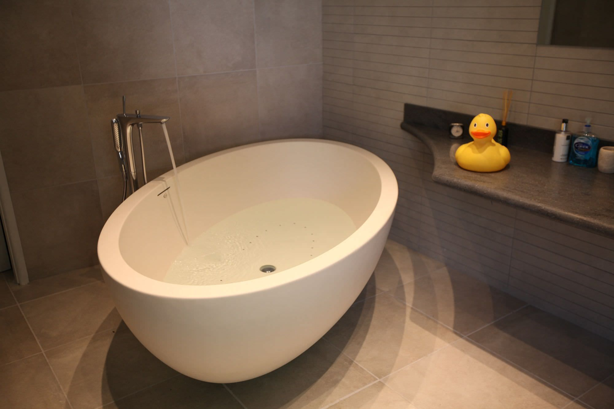 Free-standing bathtub / oval IMPERIA AIE SPA BATH IN GOLDEN SAND ...