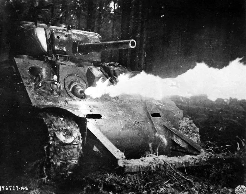 M4A2 Sherman Crocodile flaming out hidden japanese bunker.