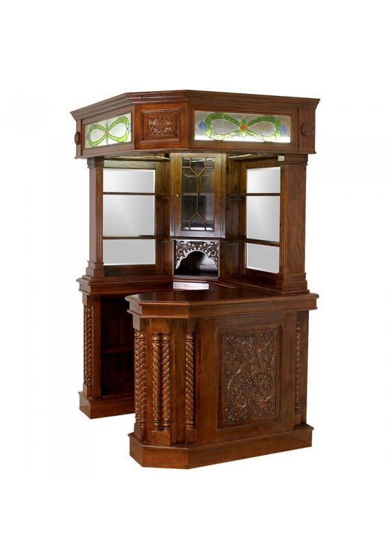 Mahogany Corner Bar Furniture w Real Tiffany Glass Canopy Antique Replica is part of Cool home Bar - Why go all the way to the Pub , when you can bring the fun to your home    Corner bar SALE PRICED only while supply lasts   We are overstocked and our loss is your gain  Solid Mahogany Hand Made and Hand Carved Corner Pub Bar Tavern Made with real hand crafted tiffany glass  Wine bottle holders Shelving and two mirrored backs All of our solid mahogany bars and furniture are   hand made and carved   and subject to natural wood movement  We believe this only enhances the natural antique hand made nature of these gorgeous pieces of furniture !    Sizes vary a bit as these are hand made 60  by 49  by 92 5  tall Fits in both left and right hand situations ( SEE all photos ! ) See all photos and drop us a line with any questions at all Toll Free 18009103497  TKBCRNERMDPUBK