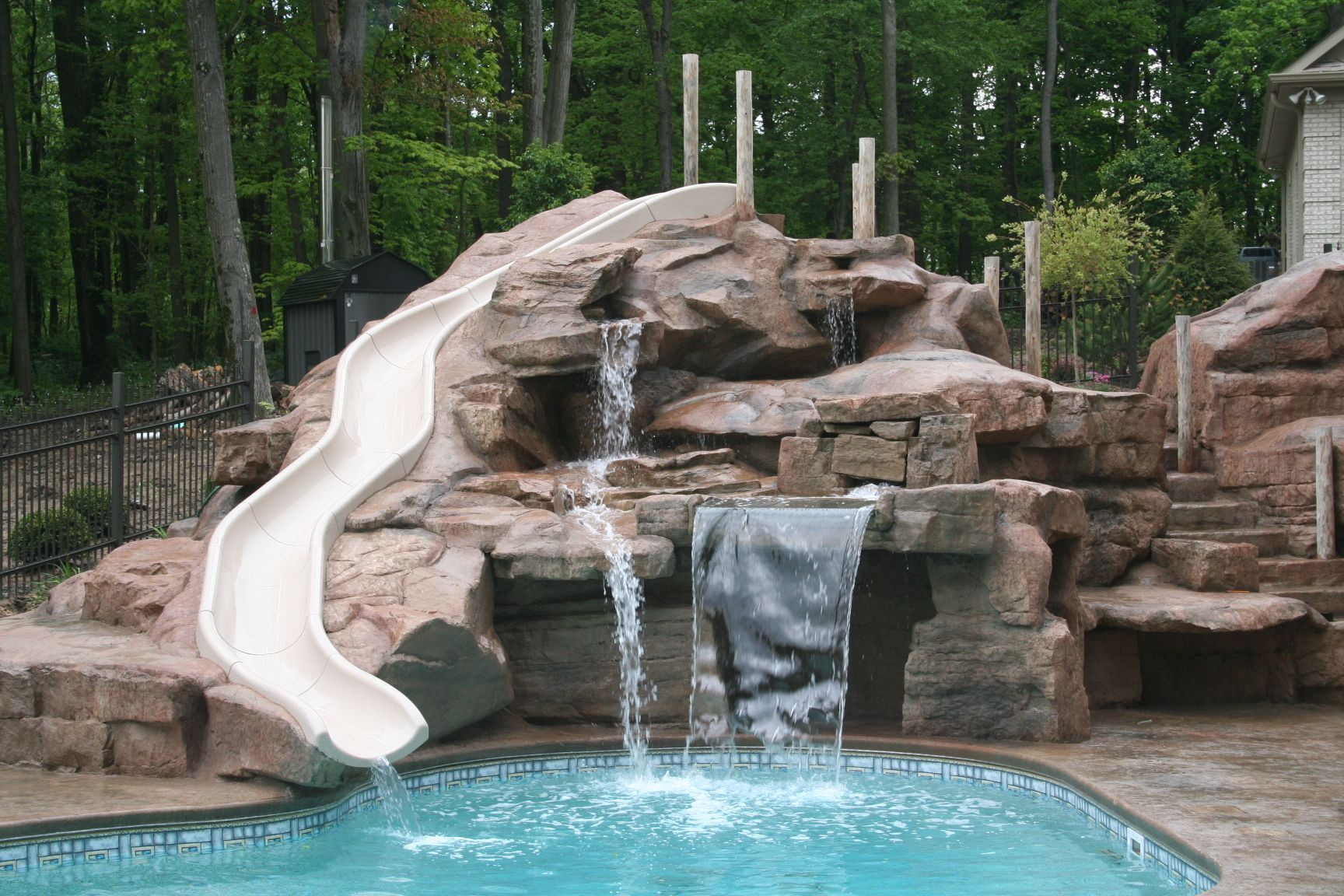 Cool Pools With Waterfalls And Slides i will someday have a fancy pool, and i want a waterfall and a