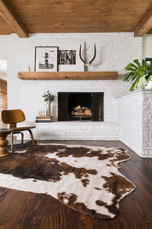 Remodelaholic Decorating Around An Off Center Non Functional Fireplace Home Decor Alexander Home Faux Cowhide Area Rug