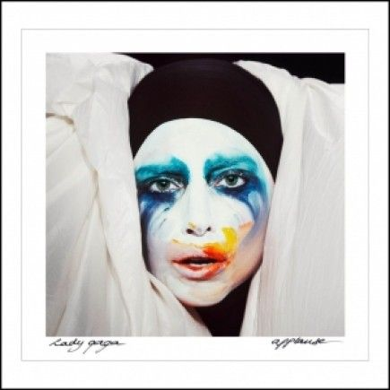 """Lady Gaga releases the cover art for her next single, """"Applause""""."""