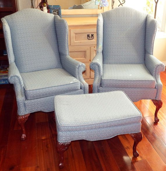 This lovely set of Wingback chairs feature a neutral and lovely Pale Blue Fabric with tiny flecks of Rose color and Dark Cherry Queen Anne