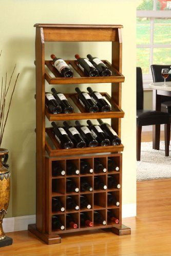 """Guarda Antique Oak 38-bottle Wine Rack by 247SHOPATHOME. $294.33. Finish: Antique oak. Storage Capacity: 38 bottles. Equipped with three (3) top racks and bottom wine slots. Dimensions: 23.5"""" W x 15"""" D x 55.25"""" H. Assembly required. Vintage meets versatility in this exquisite Guarda Wine Rack. Featuring a sturdy hardwood rack that can hold up to 38 wine bottles and an elegant antique oak finish, this piece makes an elegant display piece while providing generous storage spac..."""