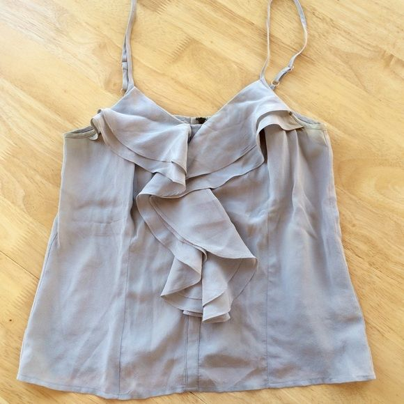 Silk Ruffle Tank (Urban Outfitters) Delicate silk tank top with ruffle front and zipper back. Urban Outfitters Silence + Noise brand. Size small. Adjustable straps. Silvery gray. Urban Outfitters Tops Blouses