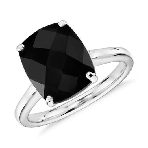 A striking black onyx makes a bold statement in this fashion-forward cocktail ring crafted of 14k white gold.
