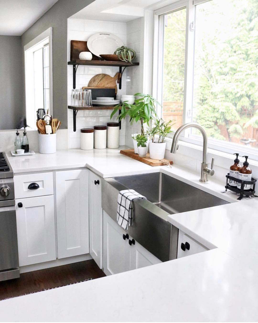 White Kitchen with quartz countertops, farmhouse stainless