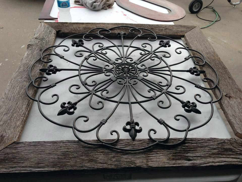 Frame wrought iron with reclaimed wood to create stunning wall art