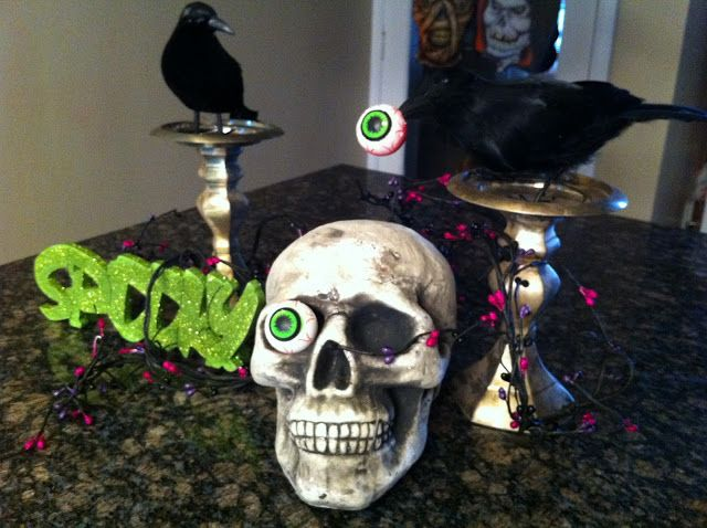 I love the door knocker and the crow with the eye in its beak All - halloween cheap decorations