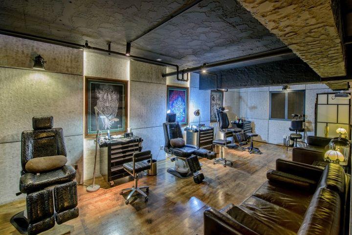 Qg tattoo studio by archetype design studio chengdu