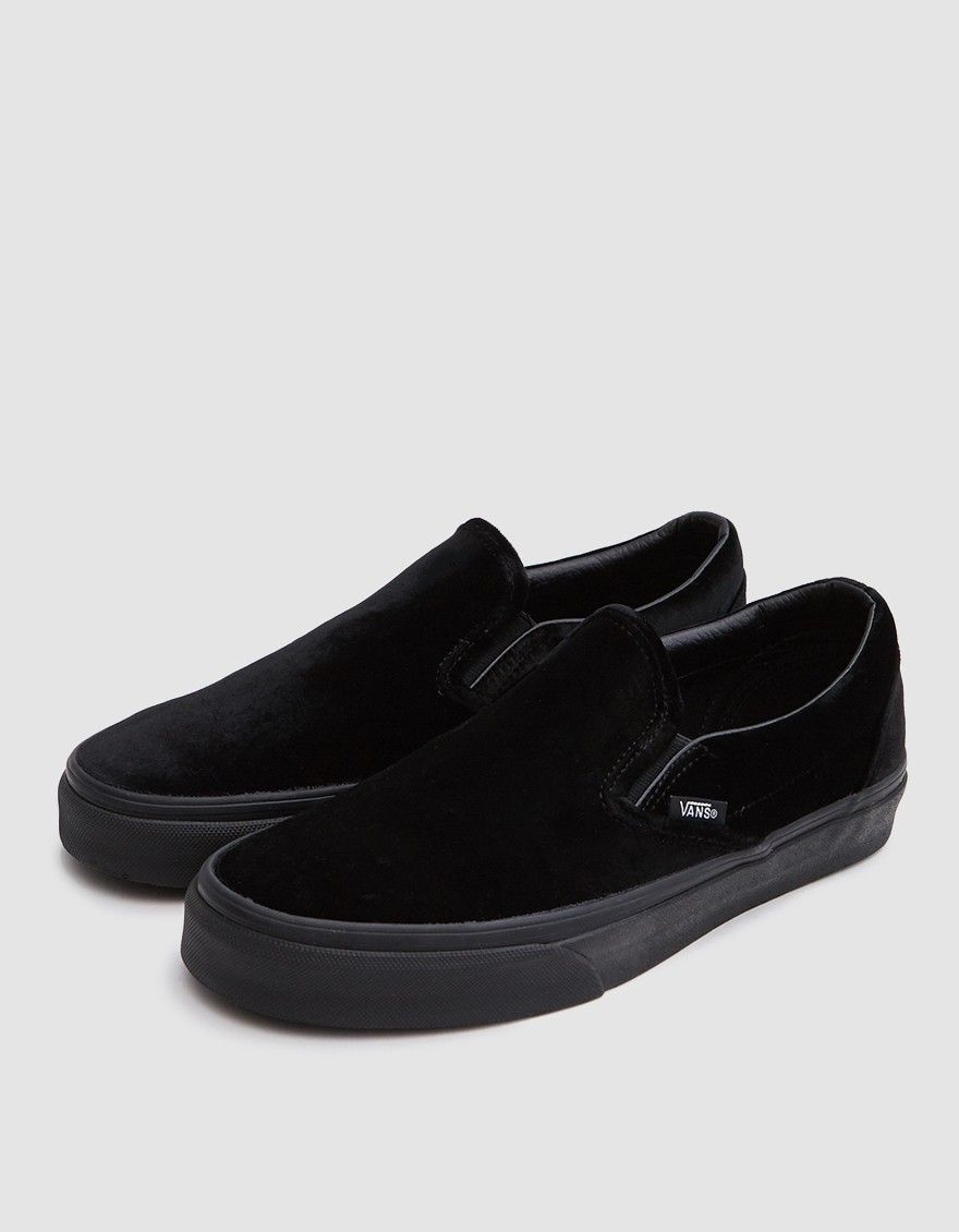 a7ed12f9157c89 Classic Slip On from Vans in Black. Velvet upper. Lightly padded collar.  Elastic goring at lateral and medial sides. Woven logo tab at lateral side.