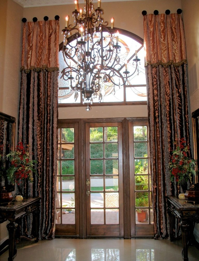 Two, extra tall decorative curtain panels on medallions with trimmed overlay
