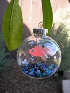 Make a fish bowl ornament with small aquarium rocks, fishing line, and a rubber fish (found at a pet store). CUTE!
