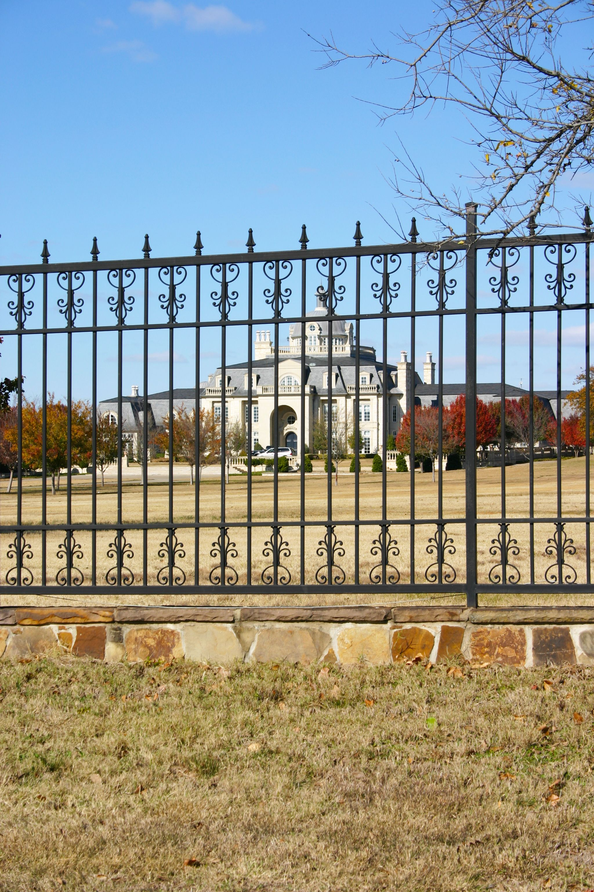 This Beautiful Ranch Fence Is Adorned With Single Faced Cast Iron