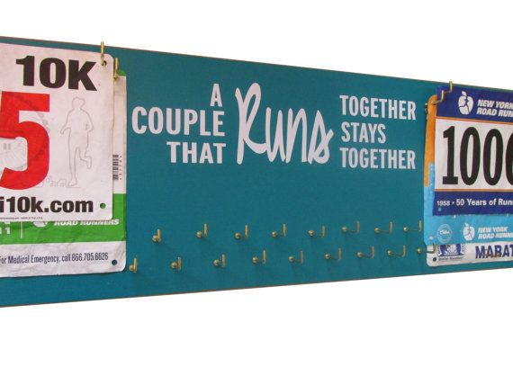 Medals display rack for running couple by runningonthewall