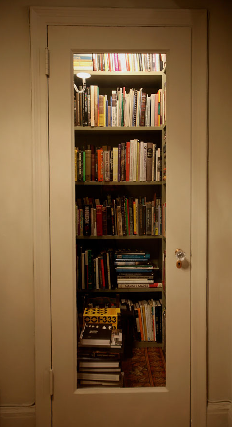 a cool way to make a tiny library of your own. take one small closet, put in shelves and cut out part of the door and put in glass. taa-dah!