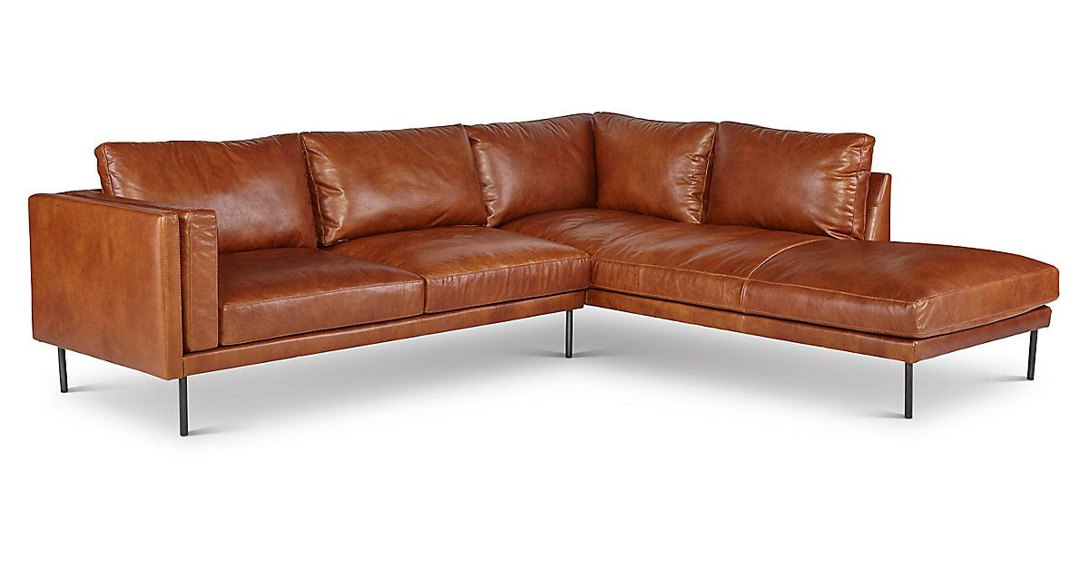 This Delightfully Modern Low Profile Sectional Is Defined By Its