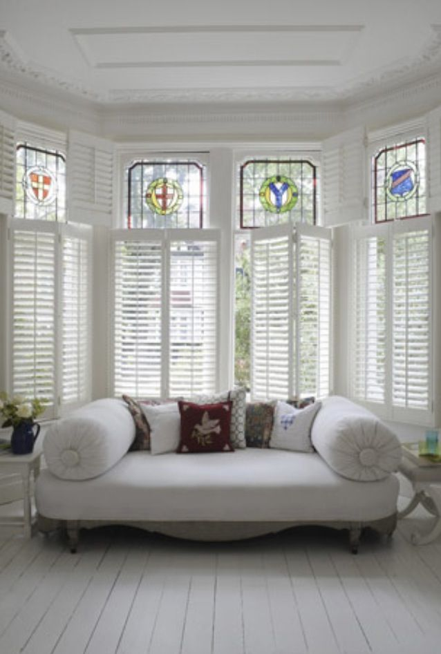 White Slatted Shutters And Stunning Stained Gl Loungeinspiration