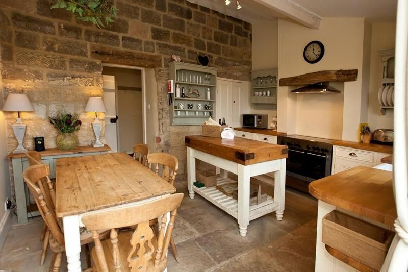 The gorgeous cottage kitchen in Egton - beautiful rustic style with flagstone flooring and chunky shabby chic furniture #livingroomideas