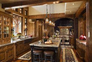 Rustic Kitchen with Raised panel, Hardwood floors, Breakfast bar, Flush, Undermount Sink, Glass panel, Wall sconce, U-shaped