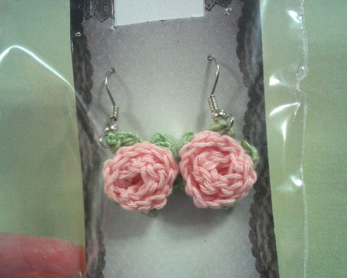 Pink crochet rosebud earrings with tiny leaves.Made with  embroidery floss. Pattern from redheart.com