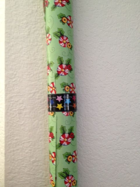 Slap bracelet to hold wrapping paper.  You can purchase these at the Dollar stores, Target 3/$2.00, or Bed Bath & Beyond $6.00 on sale now for 75% off.  This idea was given to me by my daughter Becky who works at BBB. Thanks Becky!!!