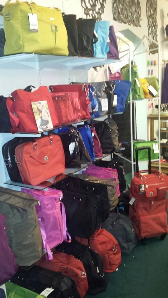 We have lots of new and great Baggallini products! So many pretty colors and new styles to see!! Designed by flight attendants, these bags are so well organized and light weight!! Come in and check them out.