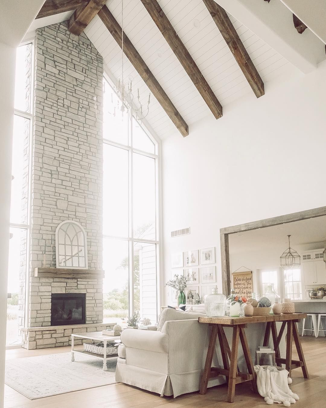 Surprising Vaulted Neutral Living Room With Stone Fireplace Farmhouse Gmtry Best Dining Table And Chair Ideas Images Gmtryco