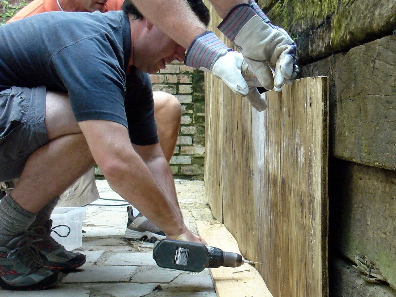 How To Cover A Stone Wall Railroad Tie Retaining Wall Stone Wall Stone Retaining Wall