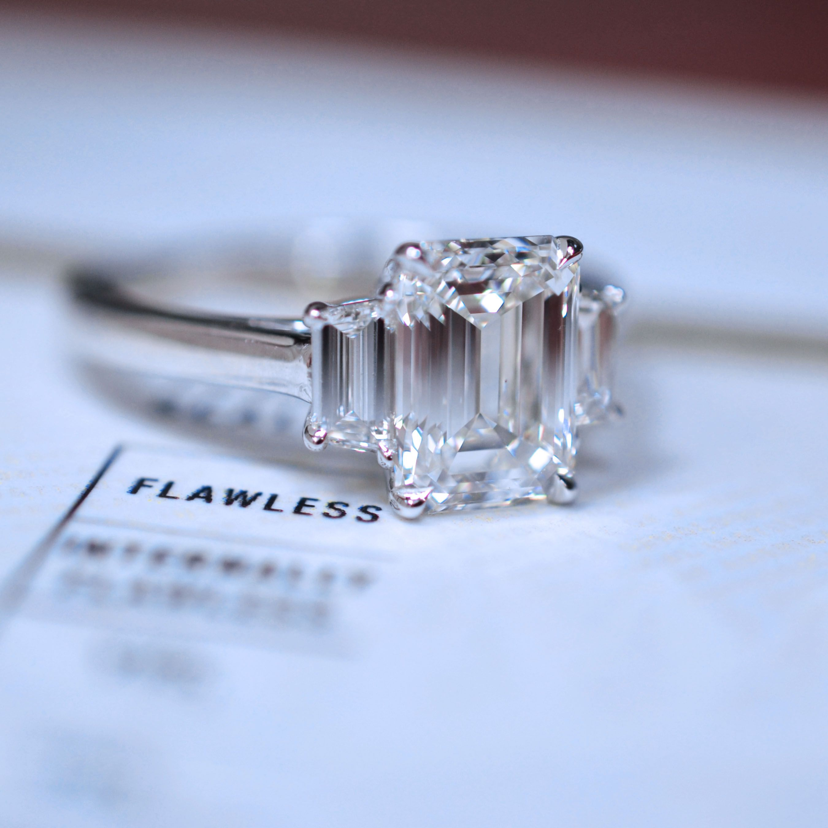 east eb west ring pin emerald cut diamond engagement