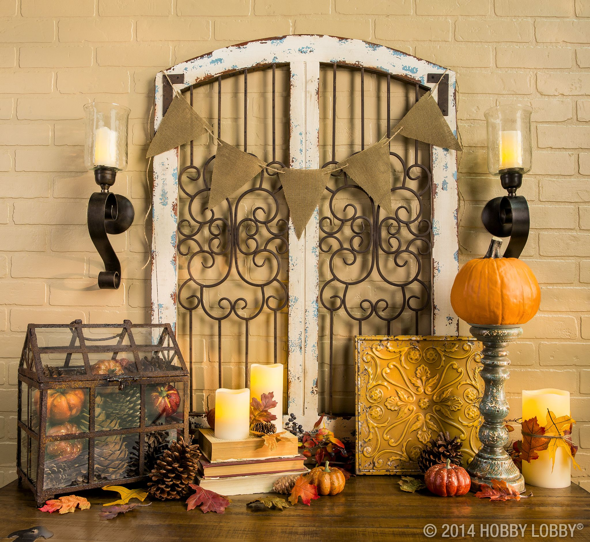 Pair metal wall art and sconces for an elegant focal point within - Hobby Lobby Halloween Decorations