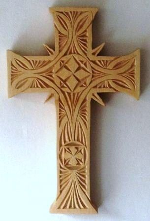 Celtic knot winding though this easy to carve cross wood carving