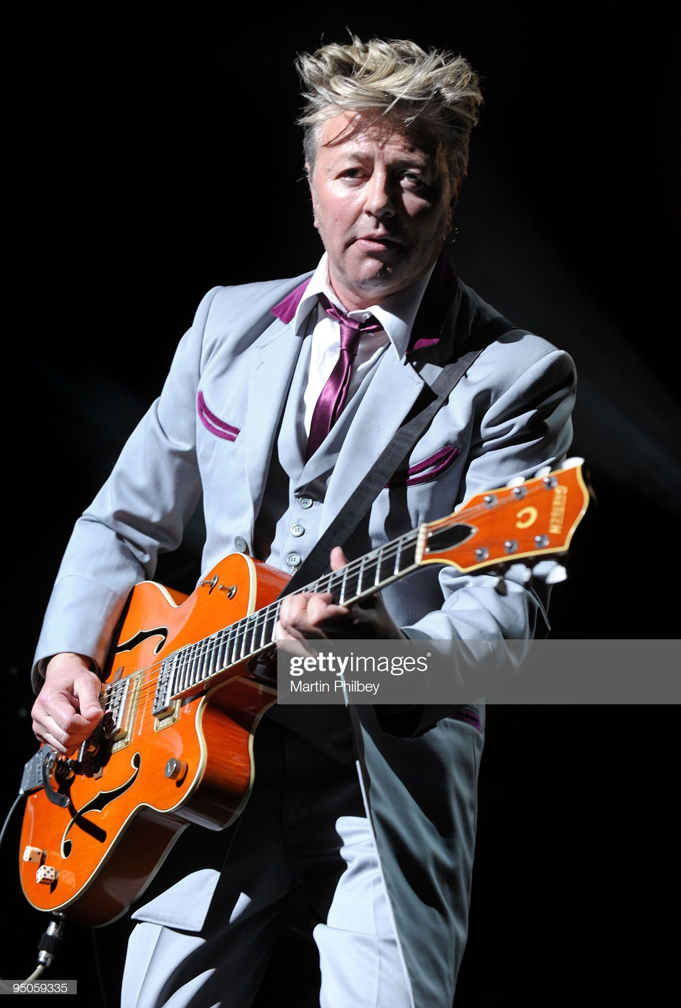 News Photo Brian Setzer of the Stray Cats performs on