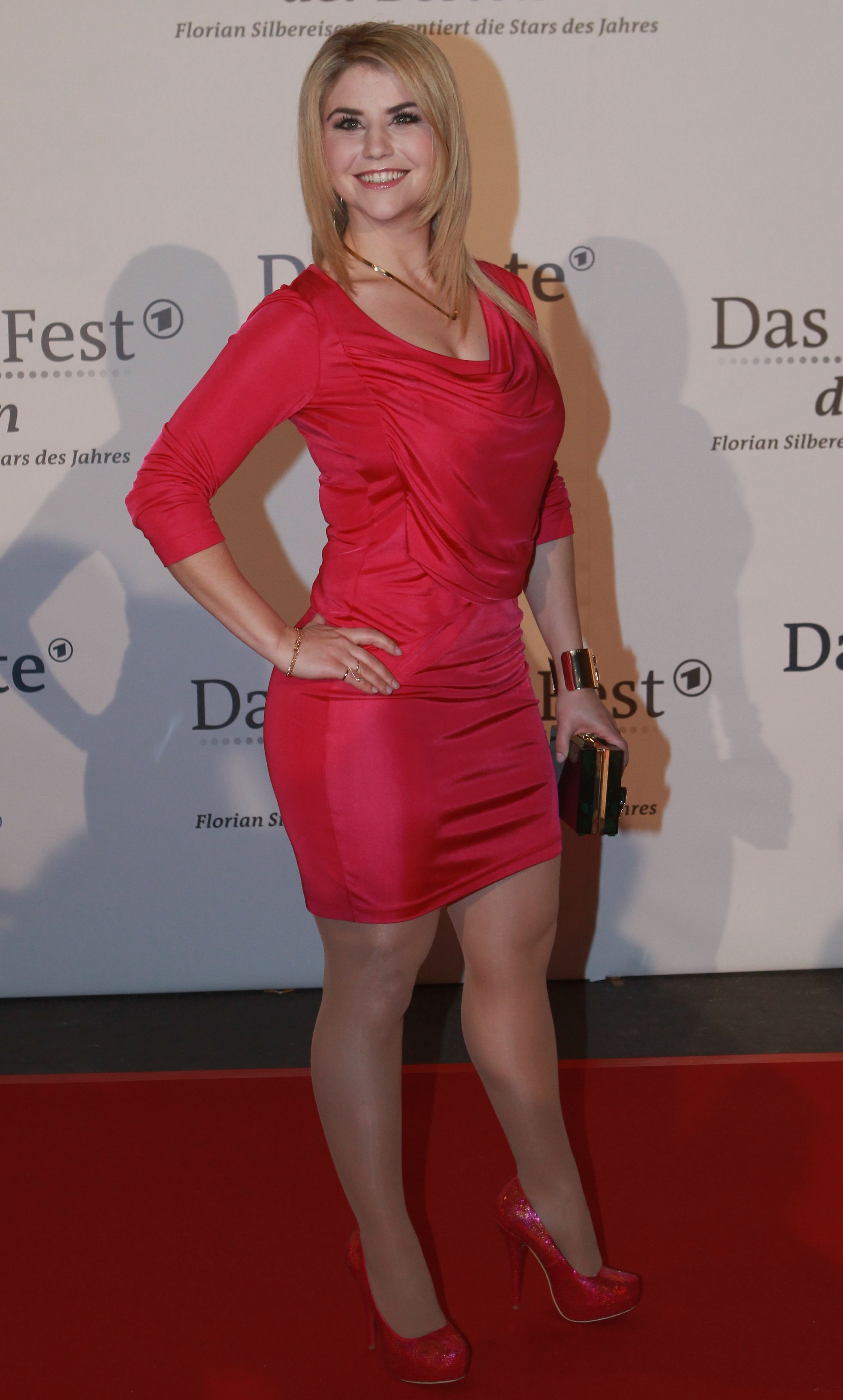 Beatrice Egli looking amazing in a little red dress