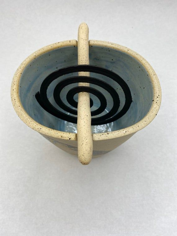 Keep those pesky mosquitos at bay with this stylish mosquito holder. It can hold up to three coils at once for maximum protection. Great for patios or camping! This coil holder is hand made on the potters wheel and the stick is hand built out of clay. The measurements are 5.75x4.5x4.25inches  Coils are not included.