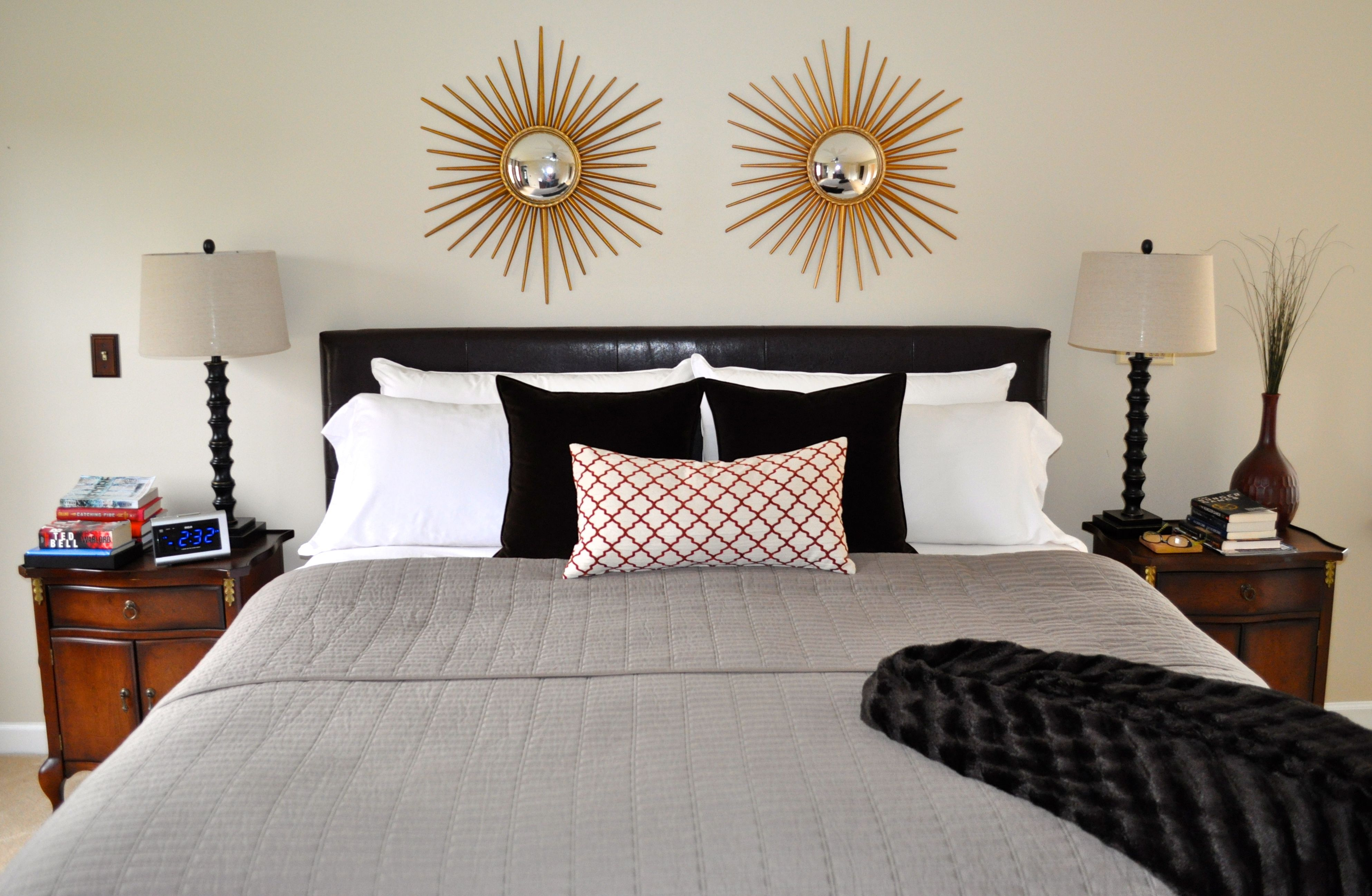 neutral bedroom with brown gray and orange color scheme