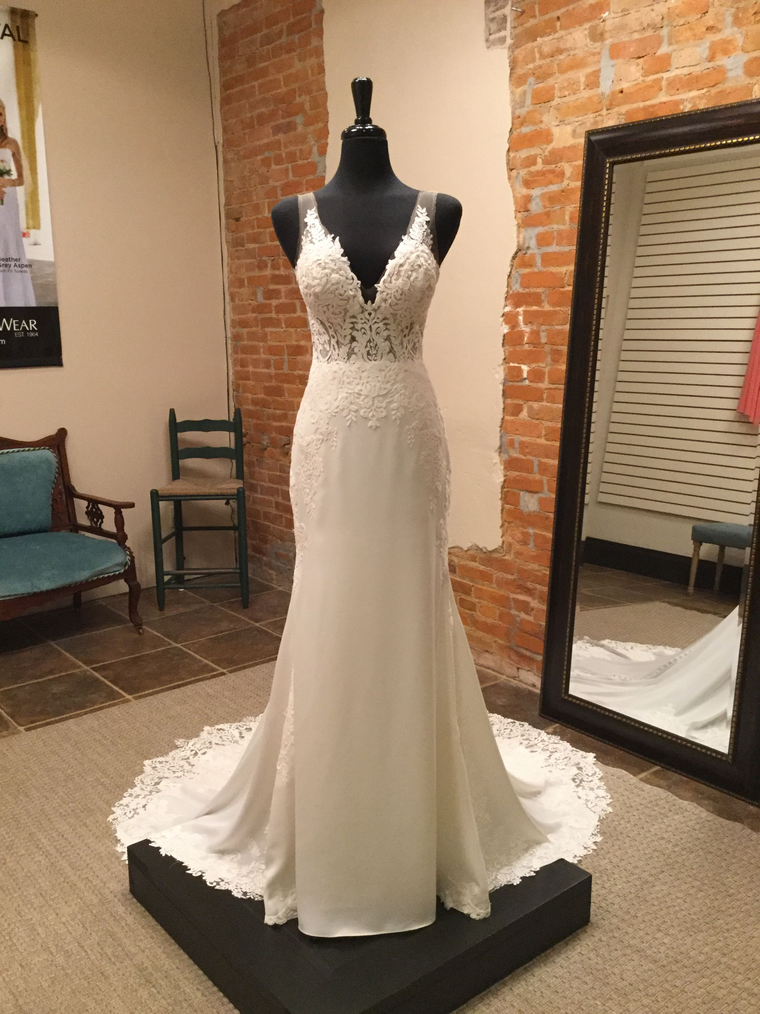 Elegant and modern wedding dress. Luxurious lace and crepe