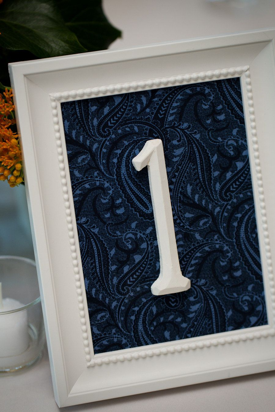 Navy and white table numbers.
