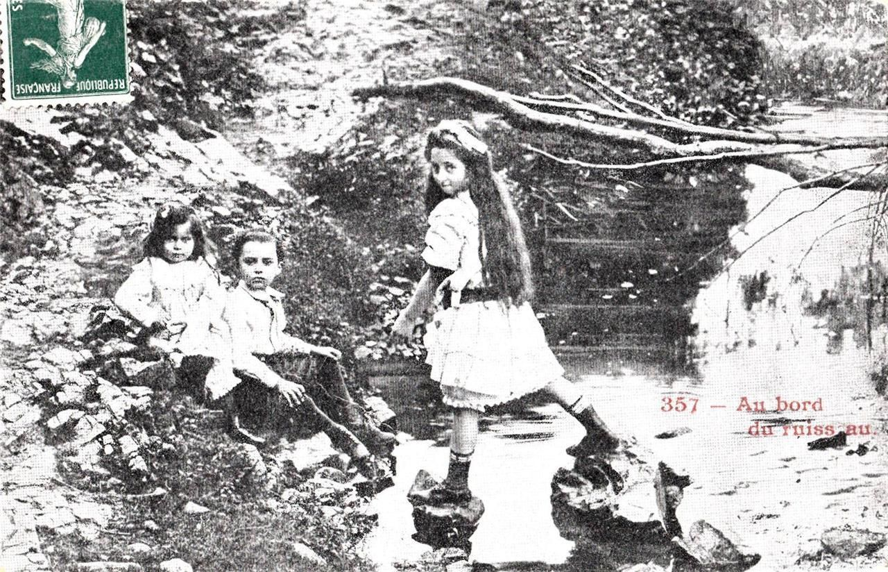 Vintage French Postcard. Children playing on the edge of a river