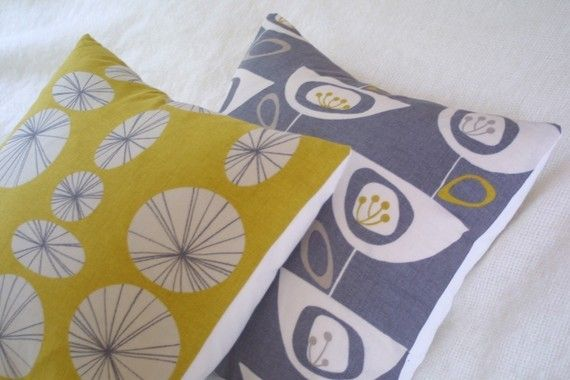 Check out this Etsy seller for a wonderful selection of cushions in retro style fabrics and reasonably priced - Connections yellow retro pillow cushion cover by ThirtyfiveFlowers, £12.00