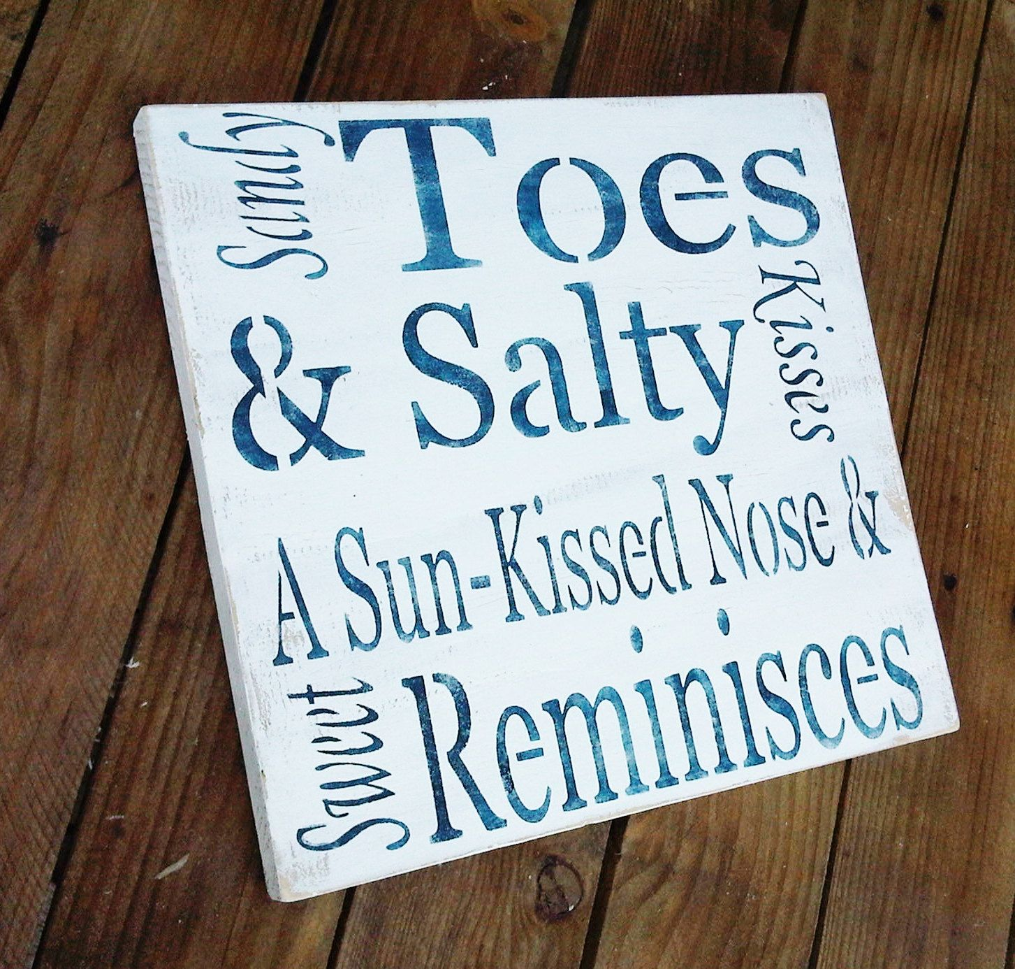 """Beach Wedding Signs, Beach House Decor """"Sandy Toes & Salty Kisses, a Sun-kissed Nose and Sweet Reminisces"""" typography word art. $39.99, via Etsy."""