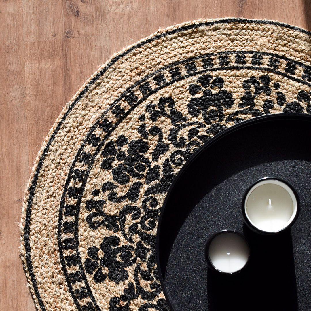 Alfombra redonda de fibras naturales de color negro