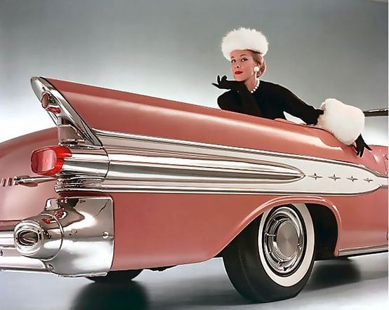 Model with a 1957 Pontiac convertible.