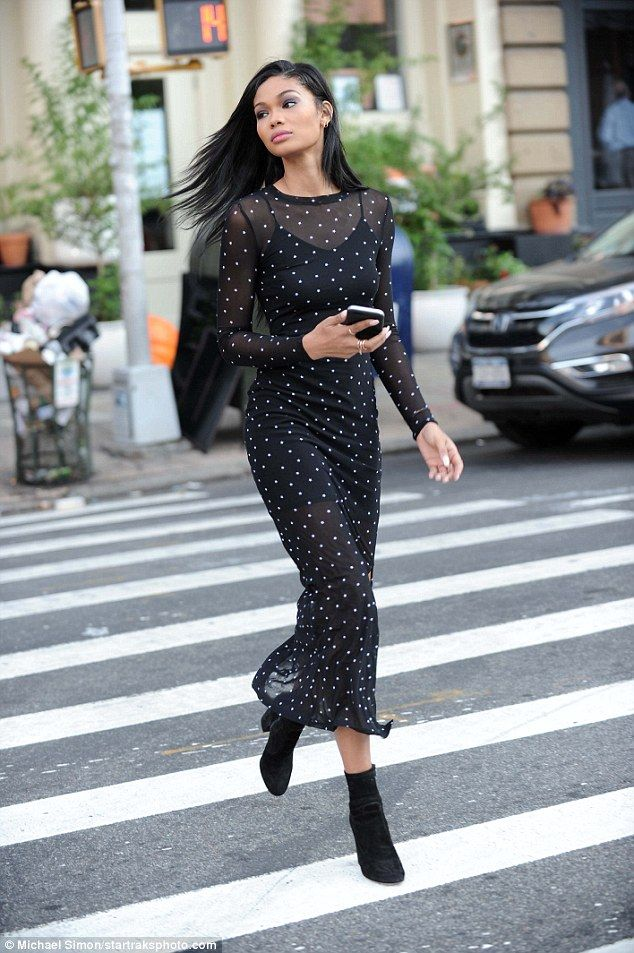Crosswalk runway: The celebrity paired the dress with black suede ankle  boots.