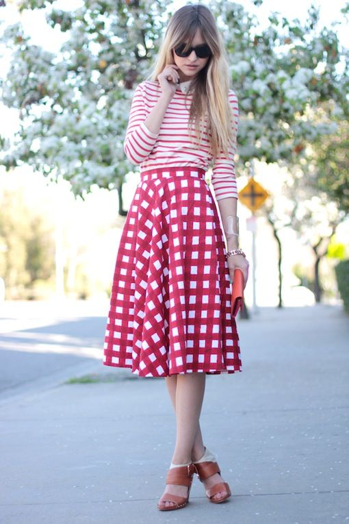 large pink check print skirt paired with striped shirt. Love the combination!