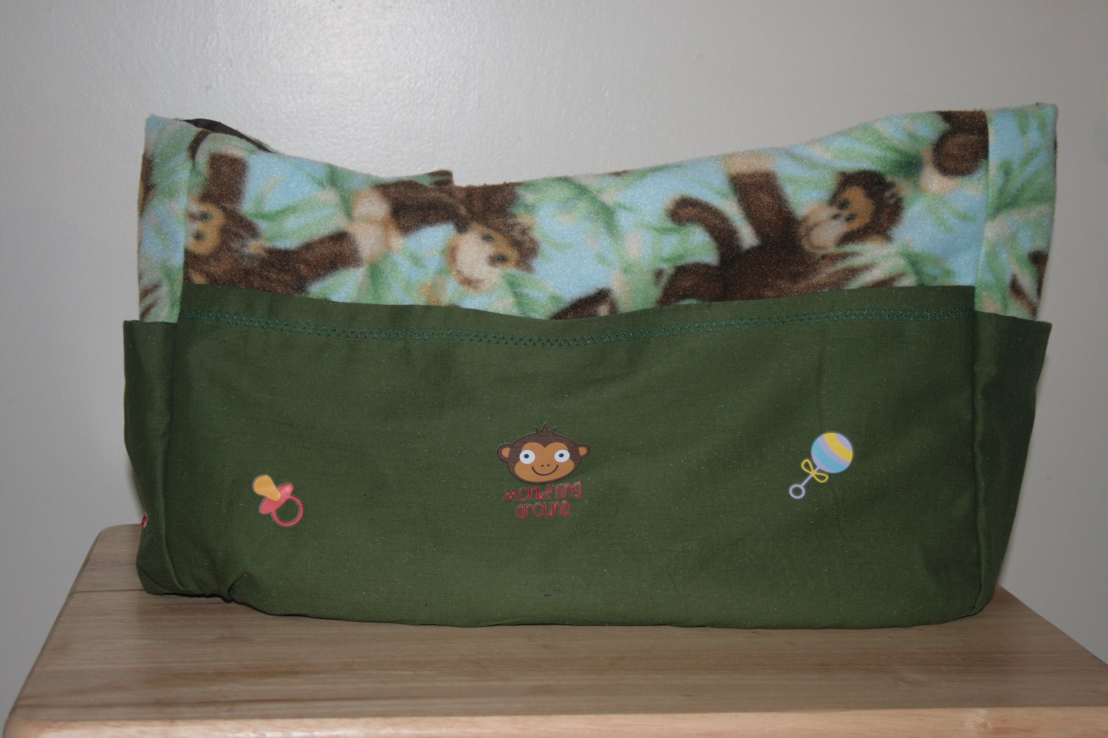 This monkey fleece fabric with green cotton and monkey appliques was