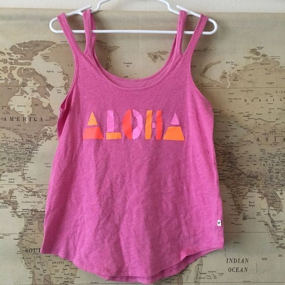 Aloha Tank Loose fit. I normally wear small and its big on me. Has two pen marks as shown in pics. One is on the inside and not seen when wearing and the other is a tiny mark that is not noticeable. ❌NO TRADES ❌ American Eagle Outfitters Tops Tank Tops