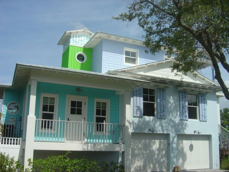Exterior Paint With Light Blue Turquoise And Bright Green On The Wall White Window Frame Door Rail Posts Of House
