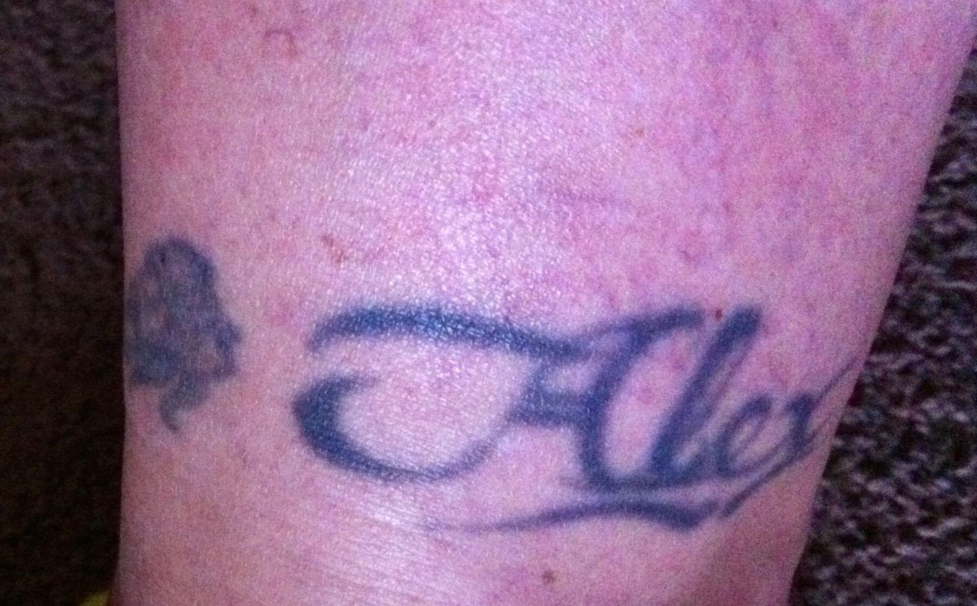 My sons name with a rose barb wire anklet by jeff kincaid early