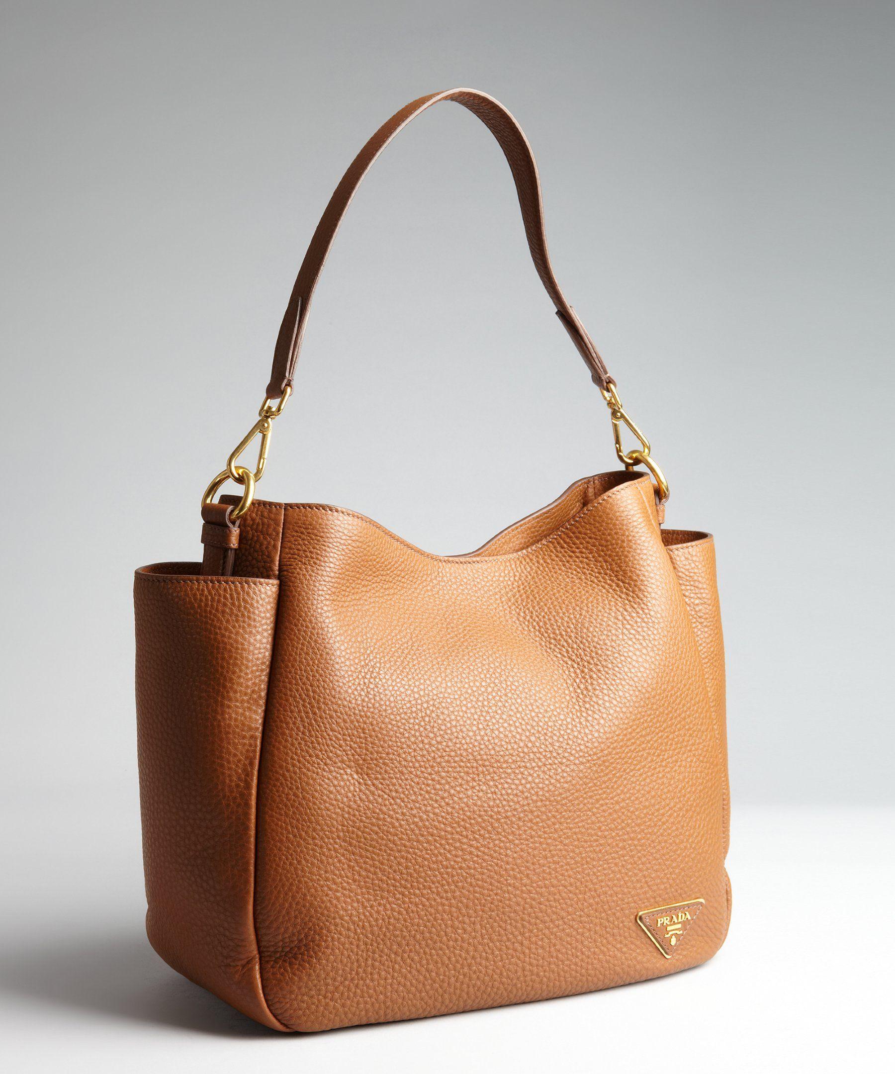 5414f13423 Prada brandy pebbled leather logo embellished hobo bag